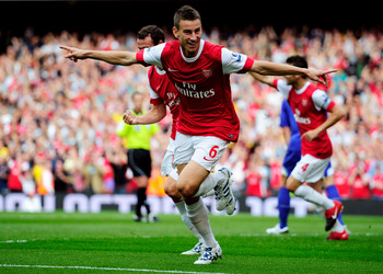 LONDON, ENGLAND - SEPTEMBER 11:  Laurent Koscielny of Arsenal celebrates after he scores the first goal of the game during the Barclays Premier League match between Arsenal and Bolton Wanderers at The Emirates Stadium on September 11, 2010 in London, Engl