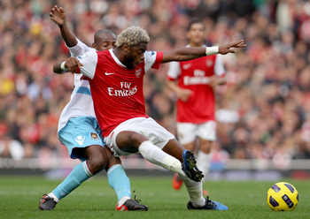 LONDON, ENGLAND - OCTOBER 30:  Alex Song of Arsenal holds off Luis Boa Morte of West Ham during the Barclays Premier League match between Arsenal and West Ham United at Emirates Stadium on October 30, 2010 in London, England.  (Photo by Clive Rose/Getty I