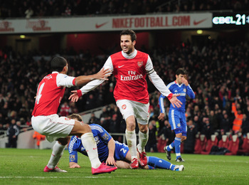 LONDON, ENGLAND - DECEMBER 27:  Cesc Fabregas of Arsenal celebrates Arsenal's second goal with Theo Walcott (L) during the Barclays Premier League match between Arsenal and Chelsea at the Emirates Stadium on December 27, 2010 in London, England.  (Photo b
