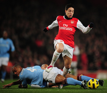 LONDON, ENGLAND - JANUARY 05:  Samir Nasri of Arsenal evades Vincent Kompany of Manchester City during the Barclays Premier League match between Arsenal and Manchester City at the Emirates Stadium on January 5, 2011 in London, England.  (Photo by Shaun Bo