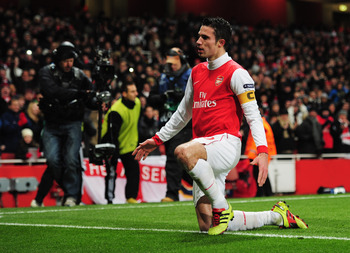 LONDON, ENGLAND - DECEMBER 08:  Robin van Persie of Arsenal celebrateds as he scores their first goal from the penalty spot during the UEFA Champions League Group H match between Arsenal and FK Partizan Belgrade at the Emirates Stadium on December 8, 2010