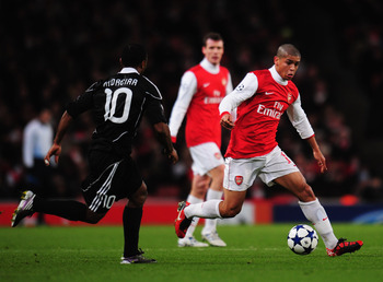LONDON, ENGLAND - DECEMBER 08:  Denilson of Arsenal takes on Almani Moreira of FK Partizan Belgrade during the UEFA Champions League Group H match between Arsenal and FK Partizan Belgrade at the Emirates Stadium on December 8, 2010 in London, England.  (P