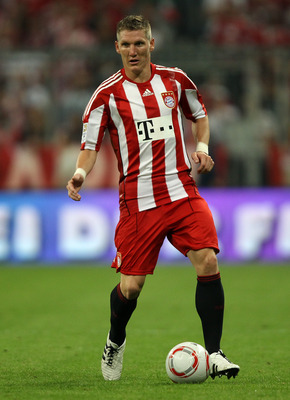 MUNICH, GERMANY - AUGUST 20:  Bastian Schweinsteiger of Bayern runs with the ball during the Bundesliga match between FC Bayern Muenchen and VfL Wolfsburg at Allianz Arena on August 20, 2010 in Munich, Germany.  (Photo by Clive Brunskill/Getty Images)