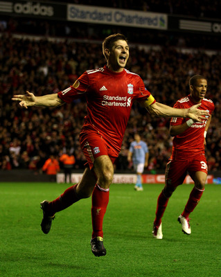 LIVERPOOL, ENGLAND - NOVEMBER 04:  Steven Gerrard of Liverpool celebrates scoring his team's third goal and hs hat trick during the UEFA Europa League Group K match beteween Liverpool and SSC Napoli at Anfield on November 4, 2010 in Liverpool, England.  (