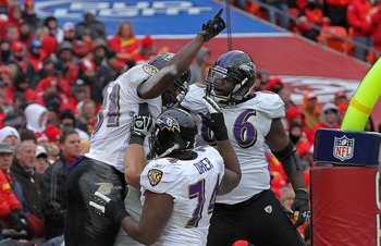 KANSAS CITY, MO - JANUARY 09:  Wide receiver Anquan Boldin #81 of the Baltimore Ravens celebrates a touchdown with teammates in the third quarter of the 2011 AFC wild card playoff game against the Kansas City Chiefs at Arrowhead Stadium on January 9, 2011