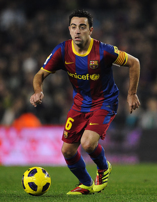 BARCELONA, SPAIN - JANUARY 02:  Xavi Hernandez of Barcelona runs with the ball during the La Liga match between Barcelona and Levante UD at Camp Nou on January 2, 2011 in Barcelona, Spain. Barcelona won 2-1.  (Photo by David Ramos/Getty Images)