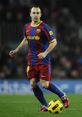 BARCELONA, SPAIN - JANUARY 02:  Andres Iniesta of Barcelona runs with the ball during the La Liga match between Barcelona and Levante UD at Camp Nou on January 2, 2011 in Barcelona, Spain. Barcelona won 2-1.  (Photo by David Ramos/Getty Images)