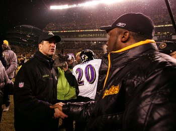 PITTSBURGH - JANUARY 18:  Head coach Mike Tomlin (R) of the Pittsburgh Steelers is congratulated by head coach John Harbaugh of the Baltimore Ravens after the Steelers won 23-14 during the AFC Championship game on January 18, 2009 at Heinz Field in Pittsb