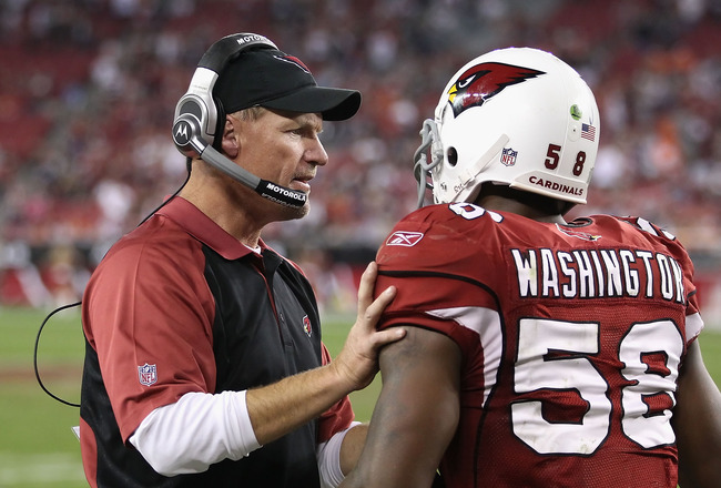 GLENDALE, AZ - DECEMBER 12:   Head coach  Ken Whisenhunt of the Arizona Cardinals talks with Daryl Washington #58 after he scored on a 40 touchdown interception against the Denver Broncos during the fourth quarter of the NFL game at the University of Phoe