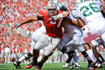 COLUMBUS, OH - SEPTEMBER 18:  Cameron Heyward #97 of the Ohio State Buckeyes chases after the ballcarrier against the Ohio Bobcats at Ohio Stadium on September 18, 2010 in Columbus, Ohio.  (Photo by Jamie Sabau/Getty Images)