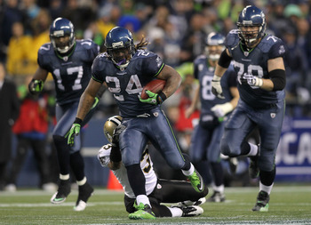 SEATTLE, WA - JANUARY 08:  Running back Marshawn Lynch #24 of the Seattle Seahawks runs for a 67-yard touchdown run in the fourth quarter against the New Orleans Saints during the 2011 NFC wild-card playoff game at Qwest Field on January 8, 2011 in Seattl