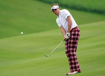 KAPALUA, HI - JANUARY 07:  Ian Poulter of England plays a shot on the 1st hole during the second round of the Hyundai Tournament of Champions at the Plantation course on January 7, 2011 in Kapalua, Hawaii.  (Photo by Sam Greenwood/Getty Images)