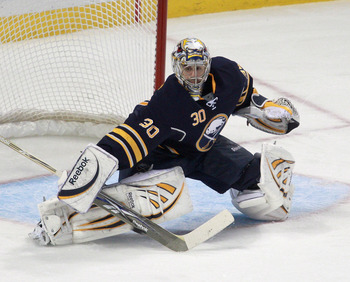 BUFFALO, NY - DECEMBER 23: Ryan Miller #30 of the Buffalo Sabres dflects a shot against the Florida Panthers at HSBC Arena on December 23, 2010 in Buffalo, New York. Florida won 4-3.  (Photo by Rick Stewart/Getty Images)