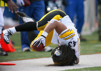 ORCHARD PARK, NY - NOVEMBER 28: Troy Polamalu #43 of the Pittsburgh Steelers rolls out of bounds after intercepting a pass against the Buffalo Bills at Ralph Wilson Stadium at Ralph Wilson Stadium on November 28, 2010 in Orchard Park, New York. Pittsburgh