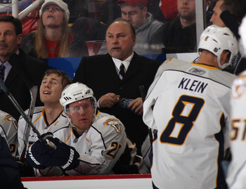 DETROIT, MI - DECEMBER 08: Head coach Barry Trotz of the Nashville Predators handles bench duties against the Detroit Red Wings at the Joe Louis Arena on December 8, 2010 in Detroit, Michigan. The Predators defeated the Red Wings 3-2.  (Photo by Bruce Ben