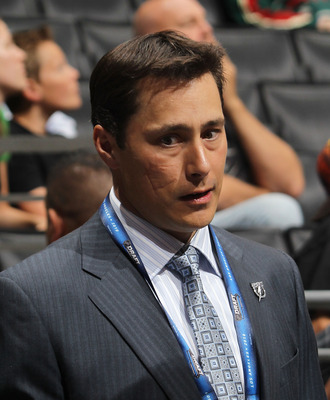 LOS ANGELES, CA - JUNE 25:  Head coach Guy Boucher of the Tampa Bay Lightning works on the draft floor during the 2010 NHL Entry Draft at Staples Center on June 25, 2010 in Los Angeles, California.  (Photo by Bruce Bennett/Getty Images)