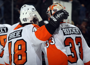 NEWARK, NJ - JANUARY 06: Danny Briere #48 of the Philadelphia Flyers congratulates Brian Boucher #33 following a 4-2 win over the New Jersey Devils at the Prudential Center on January 6, 2011 in Newark, New Jersey.  (Photo by Bruce Bennett/Getty Images)