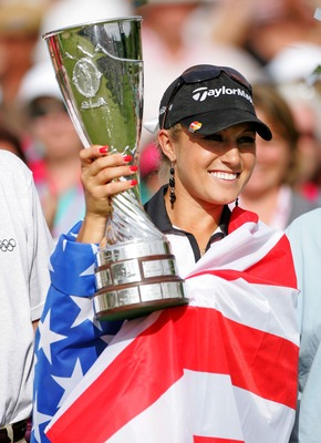 EVIAN, FRANCE - JULY 29:  Natalie Gulbis of the USA  holds the winner's trophy after winning the Evian Masters on July 29, 2007 in Evian, France.  (Photo by Andy Lyons/Getty Images)