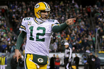 PHILADELPHIA, PA - JANUARY 09:  Aaron Rodgers #12 of the Green Bay Packers celebrates after a touchdown in the third quarter against the Philadelphia Eagles during the 2011 NFC wild card playoff game at Lincoln Financial Field on January 9, 2011 in Philad
