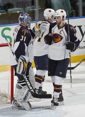 SUNRISE, FL - JANUARY 5: Goaltender Ondrej Pavelec #31 is congratulated by Andrew Ladd #16 of the Atlanta Thrashers after defeating the Florida Panthers 3-2 on January 5, 2011 at the BankAtlantic Center in Sunrise, Florida.  (Photo by Joel Auerbach/Getty