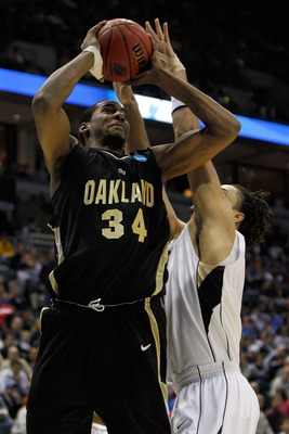 MILWAUKEE - MARCH 19:  Keith Benson #34 of the Oakland Golden Grizzlies shoots over Gary McGhee #52 of the of the Pittsburgh Panthers in the first half during the first round of the 2010 NCAA men's basketball tournament at the Bradley Center on March 19,