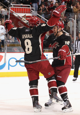 GLENDALE, AZ - JANUARY 04:  Scottie Upshall #8 of the Phoenix Coyotes celebrates with teammate Sami Lepisto #18 after Upshall scored a second period goal against the Columbus Blue Jackets during the NHL game at Jobing.com Arena on January 4, 2011 in Glend