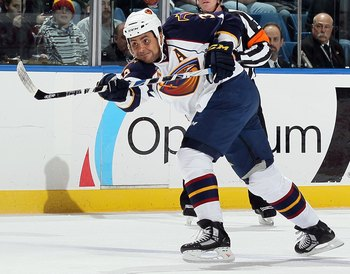 UNIONDALE, NY - DECEMBER 11:  Dustin Byfuglien #33 of the Atlanta Thrashers skates against the New York Islanders on December 11, 2010 at Nassau Coliseum in Uniondale, New York. The Thrashers defeated the Isles 5-4.  (Photo by Jim McIsaac/Getty Images)