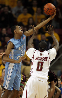 CHESTNUT HILL, MA - FEBRUARY 20:  John Henson #11 of the North Carolina Tar Heels grabs the ball as Reggie Jackson #0 of the Boston College Eagles defends on February 20, 2010 at Conte Forum in Chestnut Hill, Massachusetts.  (Photo by Elsa/Getty Images)