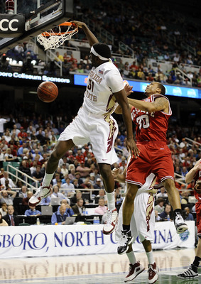 GREENSBORO, NC - MARCH 12:  Chris Singleton #31 of the Florida State Seminoles dunks in front of Johnny Thomas #30 of the North Carolina State Wolfpack in their quarterfinal game in the 2010 ACC Men's Basketball Tournament at the Greensboro Coliseum on Ma