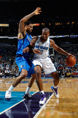 NEW ORLEANS - NOVEMBER 17:  David West #30 of the New Orleans Hornets drives the ball around Tyson Chandler #6 of the Dallas Mavericks at the New Orleans Arena on November 17, 2010 in New Orleans, Louisiana.  The Hornets defeated the Mavericks 99-97.  NOT