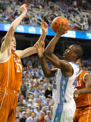 GREENSBORO, NC - DECEMBER 18:  Harrison Barnes #40 of the North Carolina Tar Heels shoots against Matt Hill #21 of the Texas Longhorns at Greensboro Coliseum on December 18, 2010 in Greensboro, North Carolina.  (Photo by Kevin C. Cox/Getty Images)