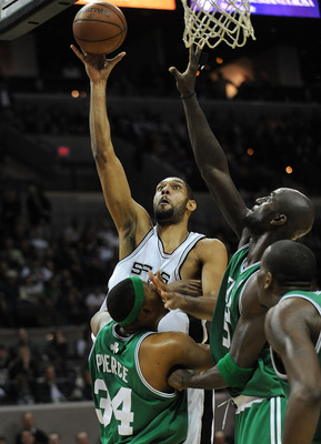 SAN ANTONIO - DECEMBER 03:  Forward Tim Duncan #21 of the San Antonio Spurs takes a shot against Paul Pierce #34 and Kevin Garnett #5 of the Boston Celtics on December 3, 2009 at AT&T Center in San Antonio, Texas.  NOTE TO USER: User expressly acknowledge