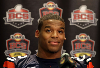 SCOTTSDALE, AZ - JANUARY 07:  Quarterback Cam Newton #2 of the Auburn Tigers talks with the media during Media Day for the Tostitos BCS National Championship Game at the JW Marriott Camelback Inn on January 7, 2011 in Scottsdale, Arizona.  (Photo by Chris