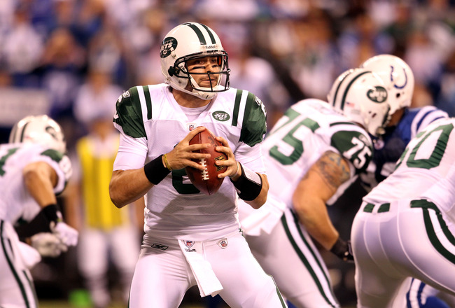 INDIANAPOLIS, IN - JANUARY 08:  Mark Sanchez #6 of the New York Jets drops back to pass against the Indianapolis Colts during their 2011 AFC wild card playoff game at Lucas Oil Stadium on January 8, 2011 in Indianapolis, Indiana. The Jets won 17-16.  (Pho