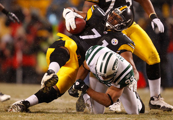 PITTSBURGH - DECEMBER 19:  Flozell Adams #71 of the Pittsburgh Steelers is tackled by Jason Taylor #99 of the New York Jets after recovering a fumble during the game on December 19, 2010 at Heinz Field in Pittsburgh, Pennsylvania.  (Photo by Jared Wickerh