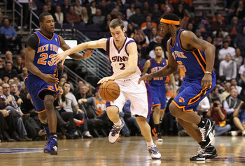 PHOENIX - JANUARY 07:  Goran Dragic #2 of the Phoenix Suns drives the ball upcourt past Toney Douglas #23 and Bill Walker #5 of the New York Knicks during the NBA game at US Airways Center on January 7, 2011 in Phoenix, Arizona.  The Knicks defeated the S