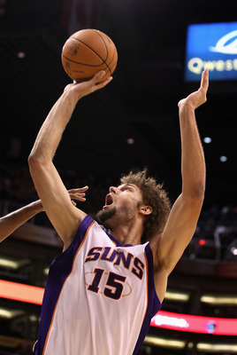 PHOENIX - OCTOBER 19:  Robin Lopez #15 of the Phoenix Suns puts up a shot against the Golden State Warriors during the preseason NBA game at US Airways Center on October 19, 2010 in Phoenix, Arizona. NOTE TO USER: User expressly acknowledges and agrees th