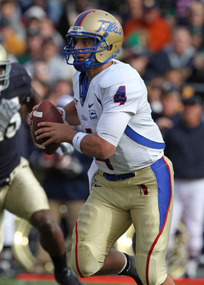 SOUTH BEND, IN - OCTOBER 30: G.J. Kinne #4 of the Tulsa Golden Hurricane rolls out to look for a receiver against the Notre Dame Fighting Irish at Notre Dame Stadium on October 30, 2010 in South Bend, Indiana. Tulsa defeated Notre Dame 28-27. (Photo by Jo