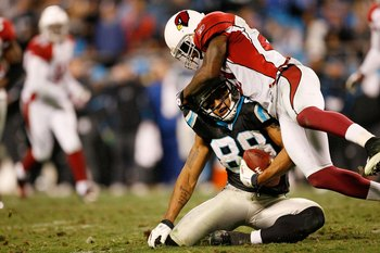 CHARLOTTE, NC - JANUARY 10: Dante Rosario #88 of the Carolina Panthers is tackled by Antrel Rolle #21 of the Arizona Cardinals during the NFC Divisional Playoff Game on January 10, 2009 at Bank of America Stadium in Charlotte, North Carolina.  (Photo by K