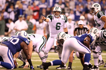 INDIANAPOLIS, IN - JANUARY 08:  Mark Sanchez #6 of the New York Jets gestures at the line of scrimmage against the Indianapolis Colts during their 2011 AFC wild card playoff game at Lucas Oil Stadium on January 8, 2011 in Indianapolis, Indiana. The Jets w