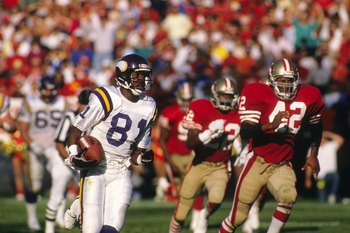 SAN FRANCISCO - OCTOBER 30:  Wide receiver Anthony Carter #81 of the Minnesota Vikings runs away from Ronnie Lott #42 of the San Francisco 49ers during a game at Candlestick Park on October 30, 1988 in San Francisco, California.  The 49er won 24-21.  (Pho