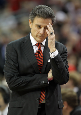 LOUISVILLE, KY - DECEMBER 31:  Rick Pitino the Head Coach of the Louisville Cardinals reacts to a turnover during the game against the Kentucky Wildcats at the KFC Yum! Center on December 31, 2010 in Louisville, Kentucky. Kentucky won 78-63. (Photo by And