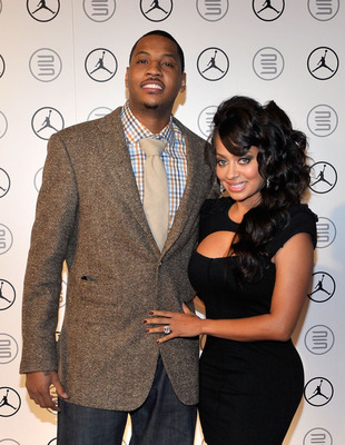 DALLAS - FEBRUARY 12:  NBA player Carmelo Anthony (L) and tv personality LaLa Vazquez attend the Exclusive FABULOUS 23 Dinner hosted by Jordan Brand during All-Star Weekend on February 12, 2010 in Dallas, Texas.  (Photo by Charley Gallay/Getty Images for