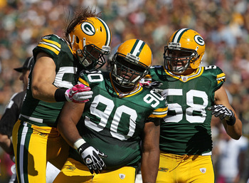 GREEN BAY, WI - OCTOBER 03: A.J. Hawk #50, B.J. Raji #90 and Frank Zombo #58 of the Green Bay Packers celebrates a defensive stop against the Detroit Lions at Lambeau Field on October 3, 2010 in Green Bay, Wisconsin. The Packers defeated the Lions 28-26.