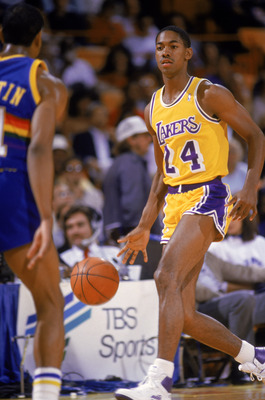 LOS ANGELES - 1986:  Adrian Branch #24 of the Los Angeles Lakers dribbles the ball during an NBA game against the Denver Nuggets at the Great Western Forum in Los Angeles, California in 1986. (Photo by: Mike Powell/Getty Images)