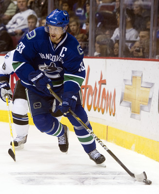 VANCOUVER, CANADA - DECEMBER 11: Henrik Sedin #33 of the Vancouver Canucks skates with the puck during NHL action on December 11, 2010 against the Tampa Bay Lightning at Rogers Arena in Vancouver, BC, Canada.  (Photo by Rich Lam/Getty Images)