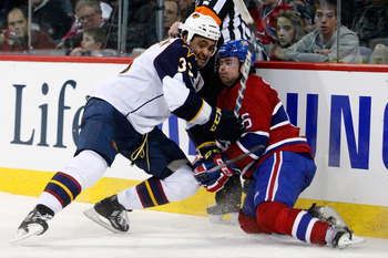 MONTREAL, CANADA - JANUARY 2:  Dustin Byfuglien #33 of the Atlanta Thrashers body checks Jaroslav Spacek #6 of the Montreal Canadiens during the NHL game at the Bell Centre on January 2, 2011 in Montreal, Quebec, Canada.  The Thrashers defeated the Canadi