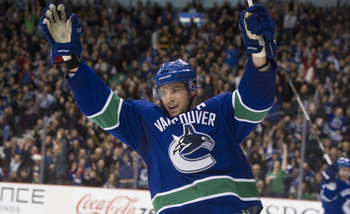 VANCOUVER, CANADA - DECEMBER 15: Ryan Kesler #17 of the Vancouver Canucks celebrates after scoring his second goal of the game against the Columbus Blue Jackets during the second period in NHL action on December 15, 2010 at Rogers Arena in Vancouver, BC,