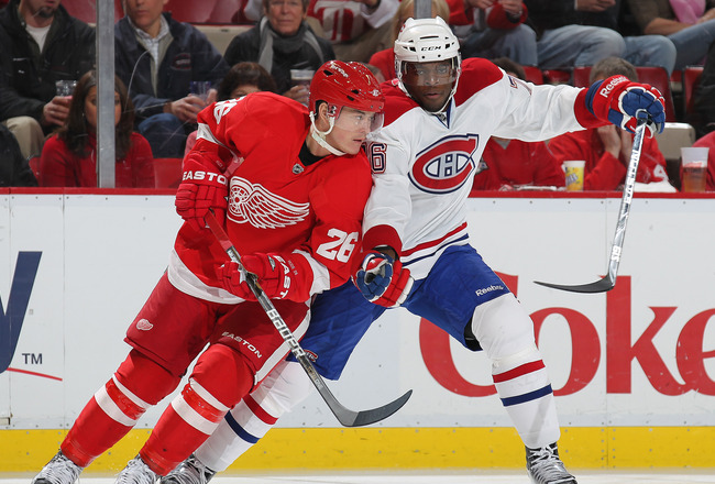 DETROIT,MI - DECEMBER 10:  P.K. Subban #76 of the Montreal Canadiens tries to hold up Jiri Hudler #26 of the Detroit Red Wings in a game on December 10, 2010 at the Joe Louis Arena in Detroit, Michigan. (Photo by Claus Andersen/Getty Images)