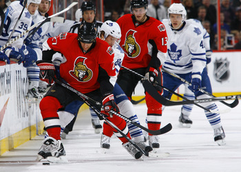 OTTAWA, ON - NOVEMBER 27:  Alex Kovalev #27 of the Ottawa Senators battles for the puck along the near boards with Mikhail Grabovski #84 of the Toronto Maple Leafs during a gam eat Scotiabank Place on November 27, 2010 in Ottawa, Ontario, Canada.  (Photo